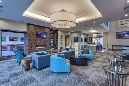 Resident lounge with fireplace wifi and comfortable seating