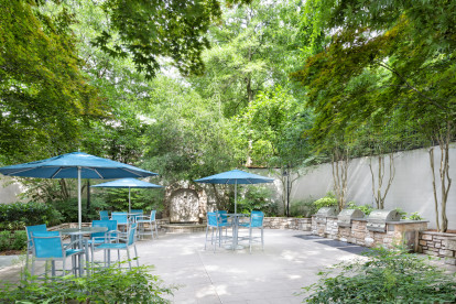 Outdoor grilling area with covered seating and serenity fountain