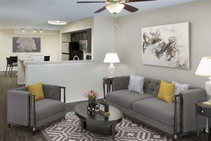 Living room with ceiling fan and wood inspired flooring