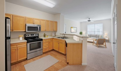 Classic finishes with open floor plans and wood style flooring with stainless steel appliances