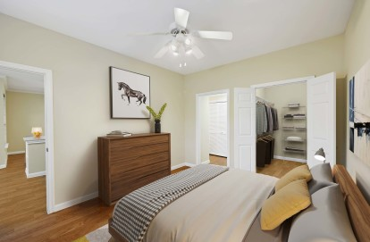 Bedroom with large closets wood style flooring and ceiling fan