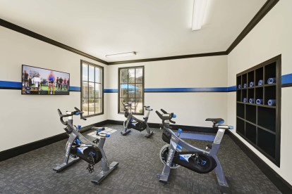 Yoga and spin room with on demand virtual trainer
