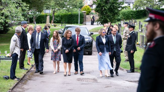 Sir Tom's family chatted and shared stories with those on the honour guard as they walked from their cars to the grave
