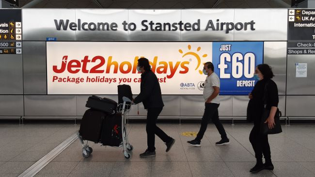Passengers at Stansted Airport, Essex, as new quarantine rules for travellers arriving in the UK are to be set out by Home Secretary Priti Patel. The plans, due to come into force on June 8, will see people arriving in the UK told to isolate for 14 days to prevent coronavirus cases being introduced from overseas.