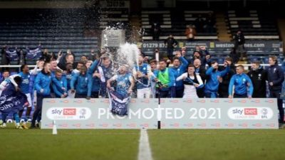 Peterborough United celebrate promotion to the Championship.