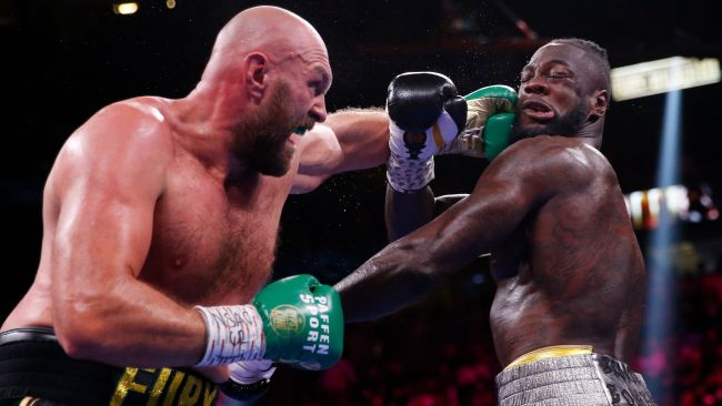 101021 Tyson Fury punches Deontay Wilder during WBA boxing match, AP