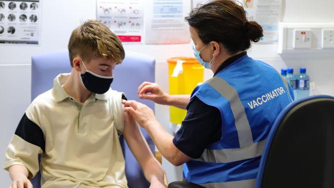 Teenager receiving Covid-19 vaccine