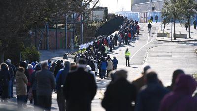 queues outside vaccine centre