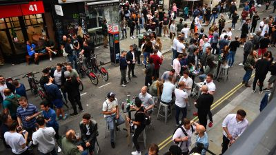People drinking on the streets of Soho, London.