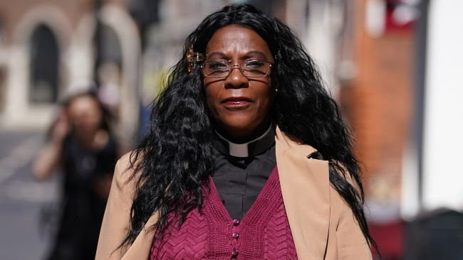 Reverend Yvonne Clarke outside the Emmanuel Centre, south west London, ahead of hearing on the closure of her south London parish, All Saints Shirley, part of the Southwark Diocese. The hearing will decide if Rev Clarke, the first black woman to become a deacon in the Church of England, can keep her parish open following proposals it be dissolved and divided between the two neighbouring parishes of St George, Shirley, and St John, Shirley. Picture date: Tuesday September 7, 2021.