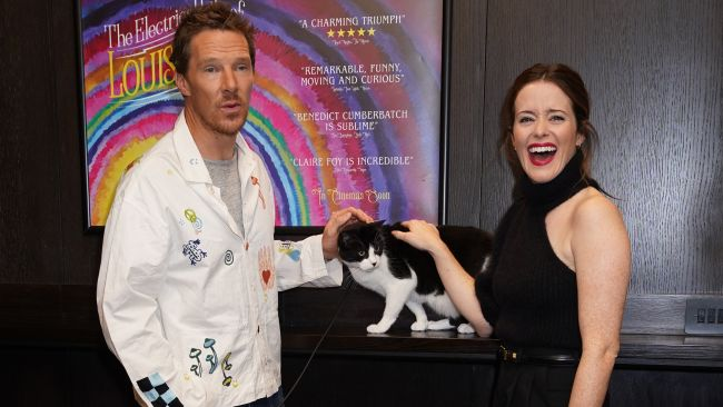 Cast members Benedict Cumberbatch and Claire Foy with Felix the cat