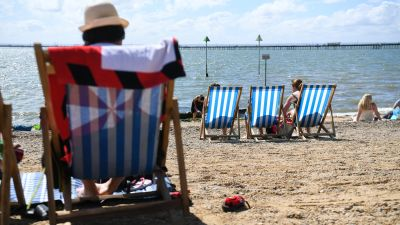 Visitors enjoy the sunny weather on the beach at Southend in Essex.