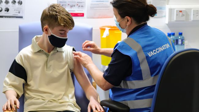 Kevin Mckeon, 14, receives his first dose of the Covid-19 vaccine from vaccinator Geraldine Flynn at the Citywest vaccination centre in Dublin. Vaccinations of children and teenagers is underway across Ireland, with more than 23 percent of those aged 12 to 15 registered to receive the jab. Picture date: Saturday August 14, 2021. Damien Storan/PA
