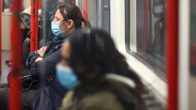Tube passengers with face masks