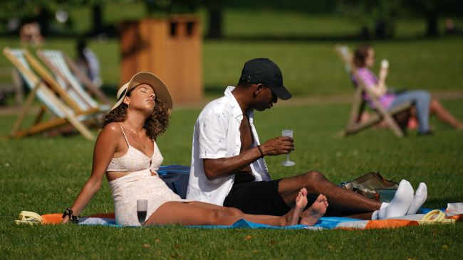 People enjoy the sun in St James's Park, London. Parts of the UK could see an official heatwave in the coming days, with temperatures hitting almost 30C (86F), forecasters have said. Picture date: Sunday September 5, 2021.