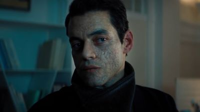 Rami Malek in the new James Bond film, No Time To Die. His character Safin has facial scarring.