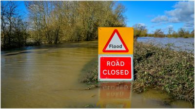 A road closed sign pokes out above floodwater and alerts motorists of flooding on the B4213 between Lower Apperlay and Tirley in Gloucestershire, which has become impassable after the River Severn has flooded the surrounding areas. PA Photo. Picture date: Monday March 2, 2020.