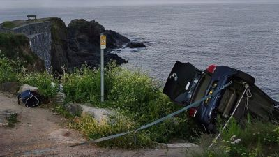 Car hangs over cliff edge at Cadgwith