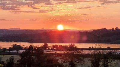Viewer Ian Faulkner sent in this snap of sunset from Keery Road, Magheramason, overlooking the River Foyle and looking into the Donegal hills.