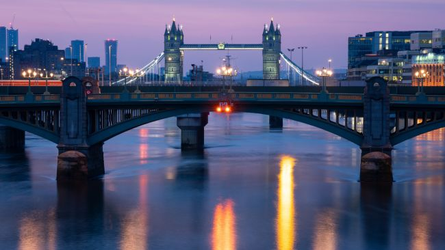 General view of the river Thames in central London at dawn, showing Southwark Bridge and Tower Bridge, after the introduction of measures to bring the country out of lockdown.