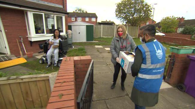 People delivering food parcels