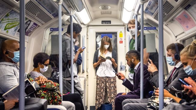 """Passengers wearing face masks on the Jubilee Line in London, as workers are being encouraged to return to their offices, with a Government PR blitz commencing this week reminding people about the efforts taken to make workplaces """"Covid-secure""""."""