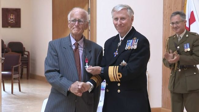Dr Richard Axton is presented with his MBE.