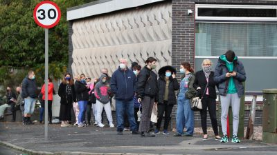 People queuing outside a walk-in coronavirus test centre at Allerton Library in Liverpool amid rising cases across parts of England, with the latest weekly infection figures showing Knowsley and Liverpool have the second and third highest rates, at 498.5 and 487.1 respectively.
