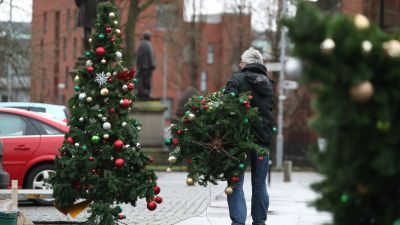 A man carries a Christmas tree