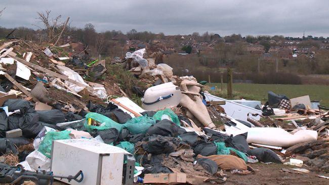 Piles of waste dumped in a field in Northampton.