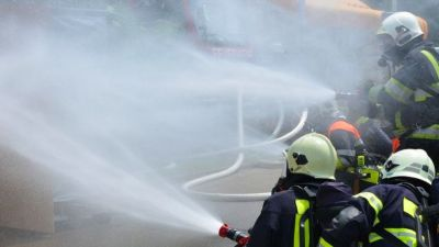 Firefighters tackling a fire that has resulted in one man going missing