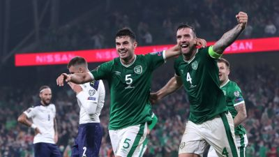 Republic of Ireland's John Egan (left) and Shane Duffy celebrates the own goal of Serbia's Nikola Milenkovic (not pictured) during the 2022 FIFA World Cup Qualifying match at Aviva Stadium, Dublin.  Picture date: Tuesday September 7, 2021. Picture by: Niall Carson / PA Images