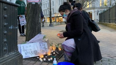 A woman lights a candle in Birmingham after the Reclaim These Streets vigil for Sarah Everard was officially cancelled.