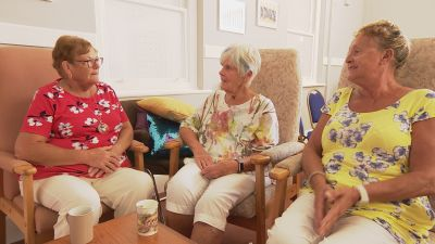 Three female sitters for a dementia charity