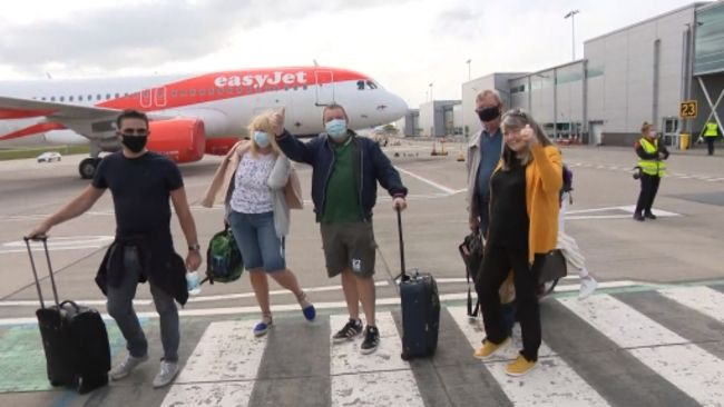Passengers boarding the first flight out of Bristol Airport since lockdown eased on May 17
