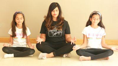 Credit: Sheena Tanna-Shah. Woman meditating with her children