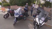 3 motorbikes parked on road.