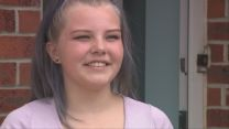 14 year-old girl with pale hair smiles.