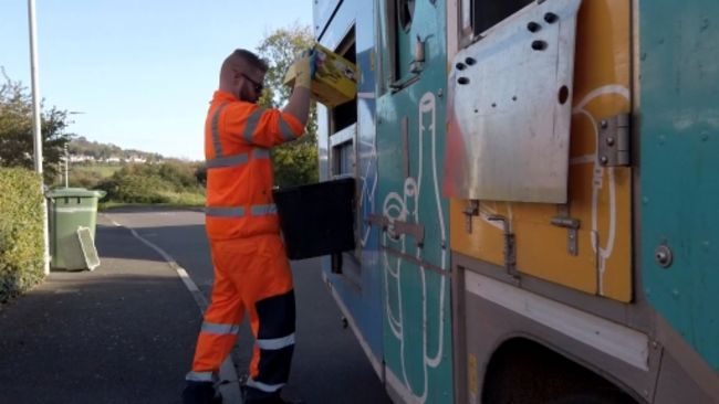 01-07-21 Bin man putting away recycling-ITV News