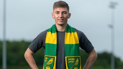 Billy Gilmour poses for pictures with a Norwich City scarf.