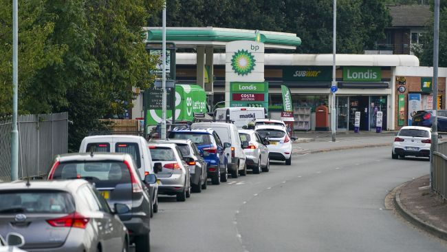 Cars queue for fuel at a BP petrol station in Bracknell, Berkshire. Picture date: Sunday September 26, 2021.
