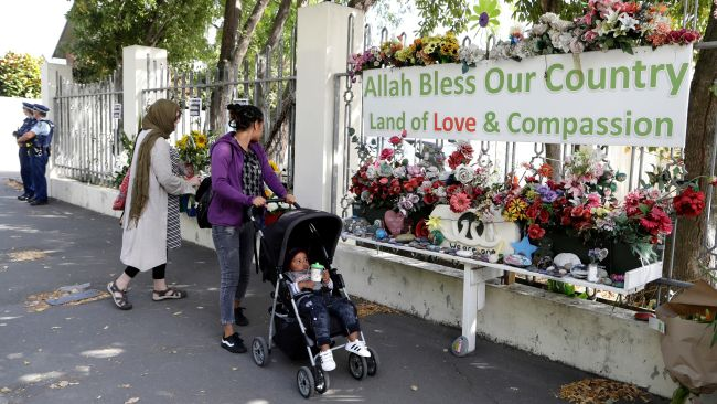 Tributes are left at the scene of one of the shootings in 2019