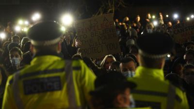 A woman holds up a placard as people gather in Clapham Common, London, after the Reclaim These Streets vigil for Sarah Everard was officially cancelled. Serving police constable Wayne Couzens, 48, has appeared in court charged with kidnapping and killing the marketing executive, who went missing while walking home from a friend's flat in south London on March 3. Picture date: Saturday March 13, 2021.