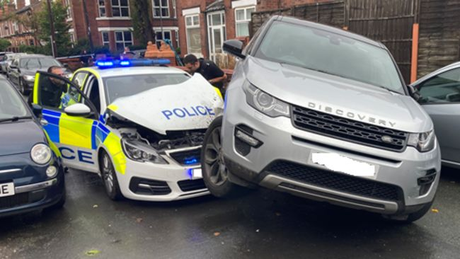 Two arrested after car rams police vehicle