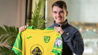 Liam Gibbs poses with his new Norwich City shirt.