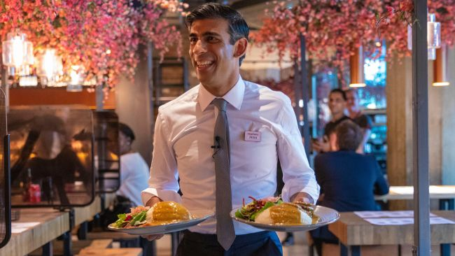 Rishi Sunak served food at Wagamamas after delivering his summer statement.