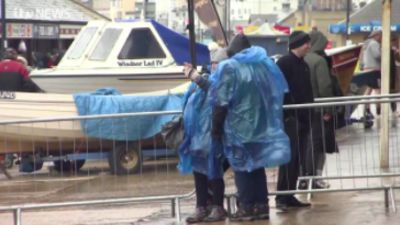 Couple in raincoats in Filey