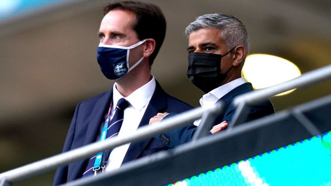 Mayor of London Sadiq Khan (right) in the stands ahead of the UEFA Euro 2020 Group D match at Wembley Stadium, London.