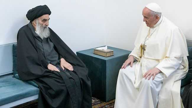 Pope Francis, right, meets with Iraq's leading Shiite cleric, Grand Ayatollah Ali al-Sistani in Najaf, Iraq, Saturday, March 6, 2021.