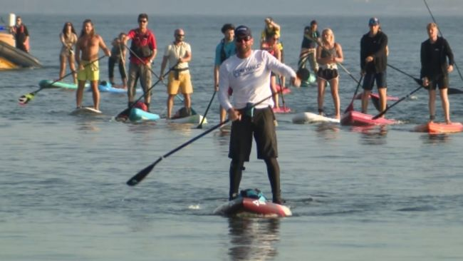 Brendan Prince arriving in Torquay as he completed his circumnavigation of mainland Britain on a stand up paddle board.